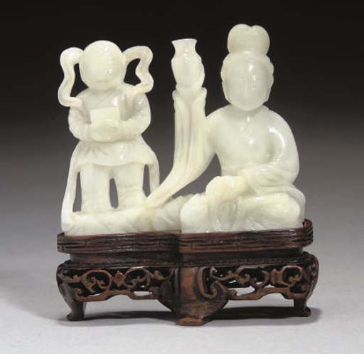 A Chinese pale celadon carving