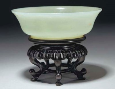 A Chinese celadon jade shallow