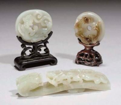 A Chinese pale celadon jade di