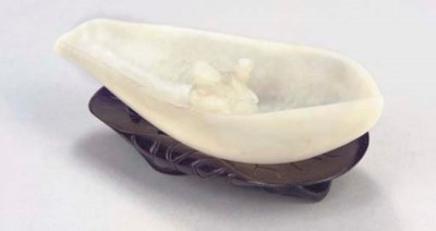 A Chinese mottled white jade p