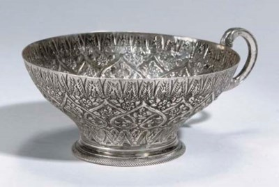 AN OTTOMAN SILVER REPOUSSE CUP