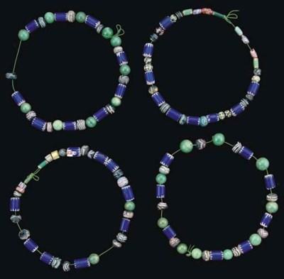 FOUR BLUE BEAD NECKLACES, IRAN