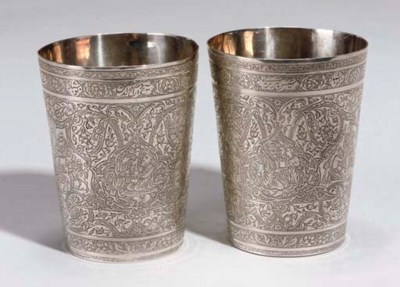 A PAIR OF SIGNED SILVER CUPS,