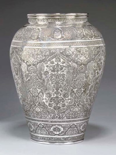 A PERSIAN WHITE METAL VASE, IS