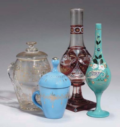 A GROUP OF FOUR GLASS VESSELS,