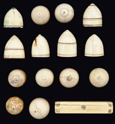 A GROUP OF IVORY GAMING PIECES
