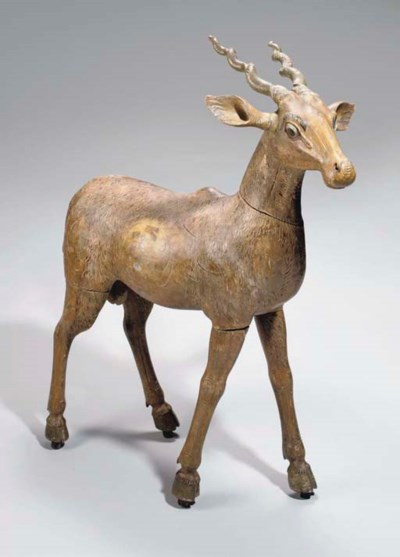 A CARVED WOODEN DEER, INDIA, 1