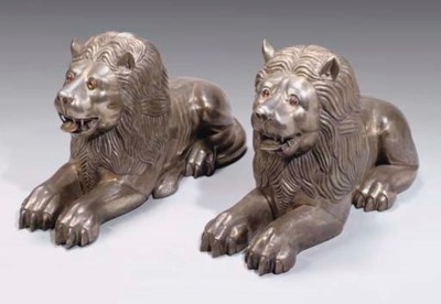 A PAIR OF HAMMERED METAL LIONS
