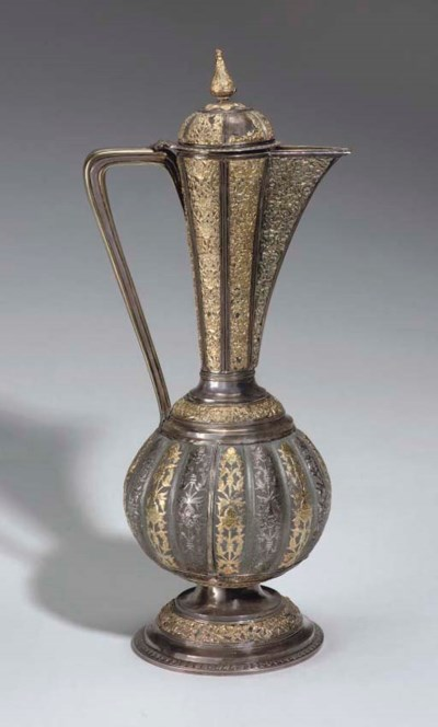 A SILVER AND GOLD PARCEL EWER,