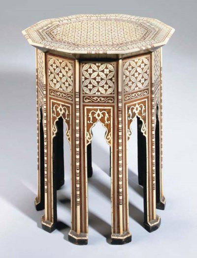 AN IVORY OCTAGONAL OCCASIONAL