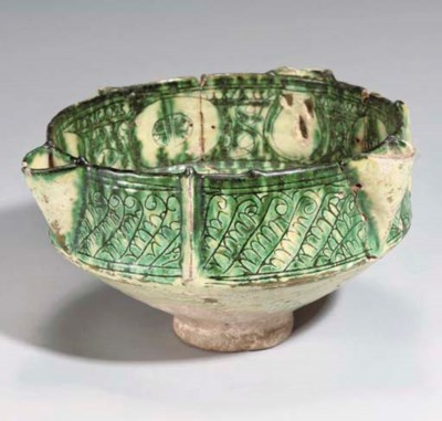 AN INCISED AMOL POTTERY POURIN