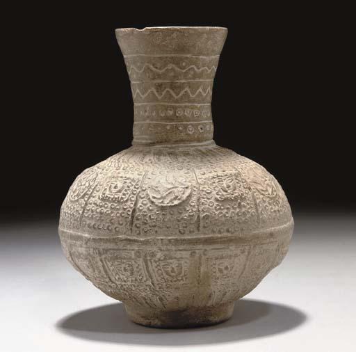 AN UNGLAZED POTTERY WATER BOTTLE, IRAN, 11TH/12TH CENTURY