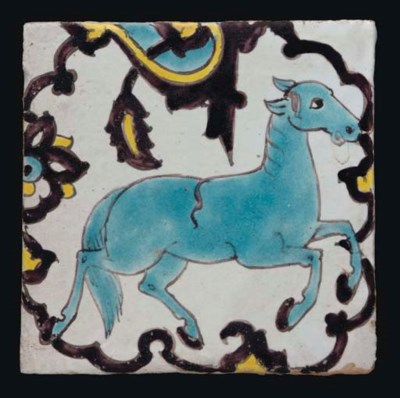 A QAJAR TILE WITH HORSE, IRAN,