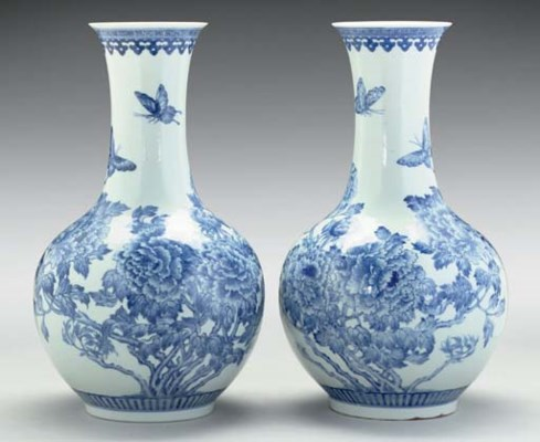 A pair of blue and white bottl