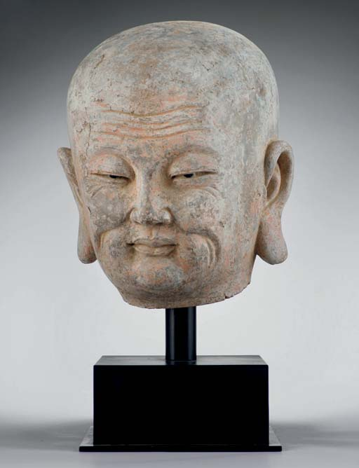 A large stucco head of a luoha