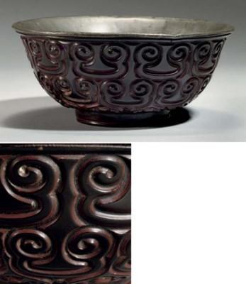 A large tixi lacquer bowl, ear