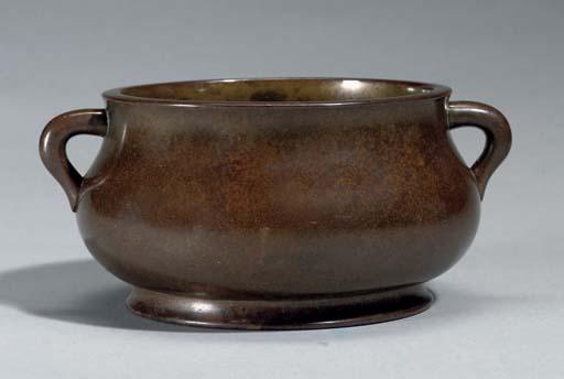 A compressed bronze censer, 17