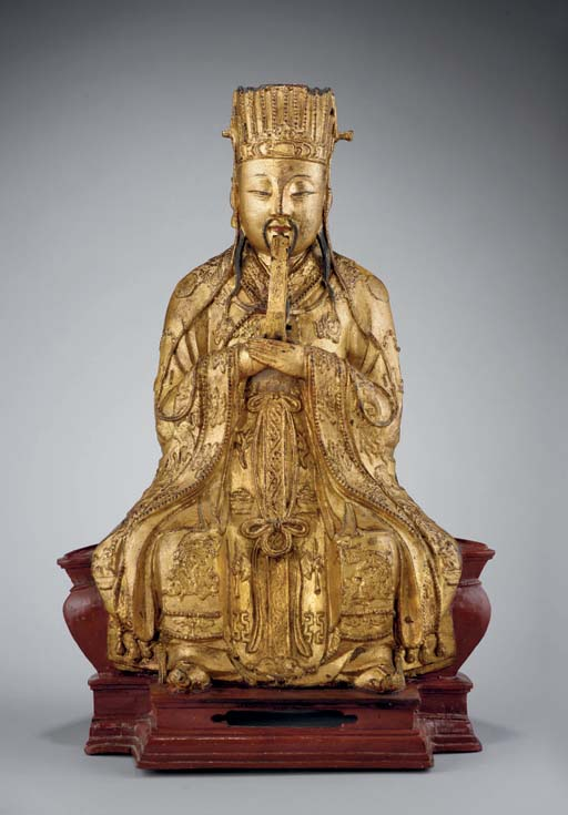 A lacquered and gilt bronze mo