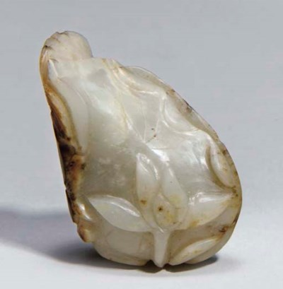 A Chinese jade and russet gold