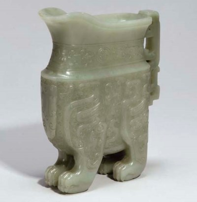 A Chinese celadon jade archais