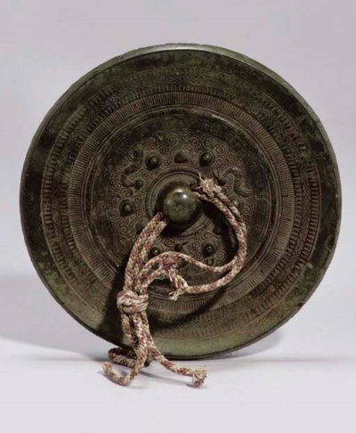 A Chinese bronze mirror, Song