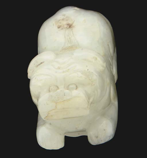 A Chinese celadon jade carving