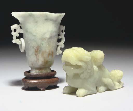 A Chinese celadon jade lion gr