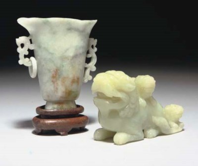 A Chinese celadon jade lion gr