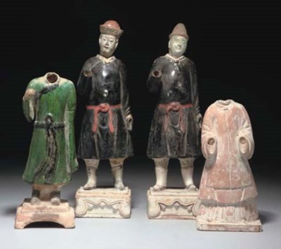 Four pottery nodding-head figu