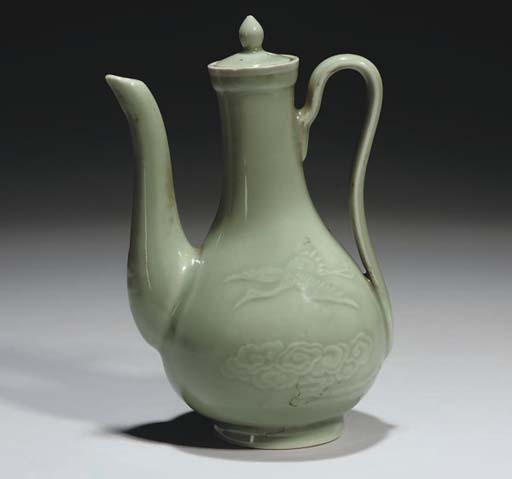 A Chinese celadon ewer and cov