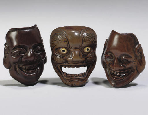 A group of four Japanese wood mask netsuke, Deme School, late 18th and 19th Century