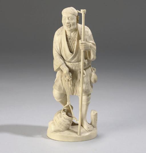 A Japanese ivory okimono of a fisherman, signed Isshin, 19th Century