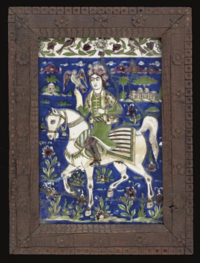A QAJAR MOULDED TILE WITH FALC