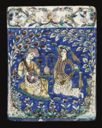 A QAJAR MOULDED TILE WITH MUSI