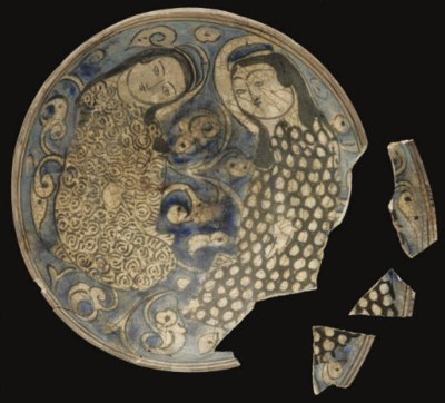 A KASHAN BLUE AND WHITE FRAGME