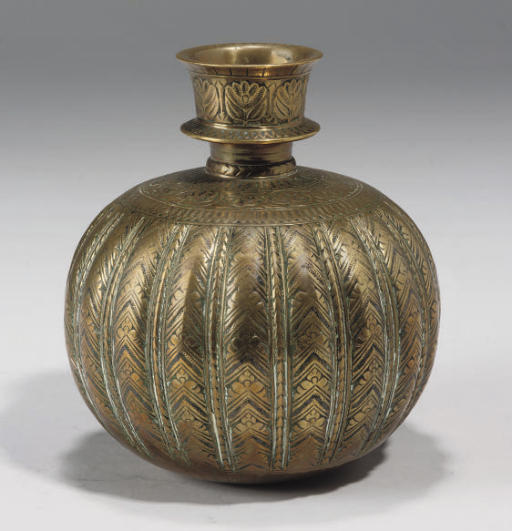 AN ENGRAVED BRASS HUQQA BASE,