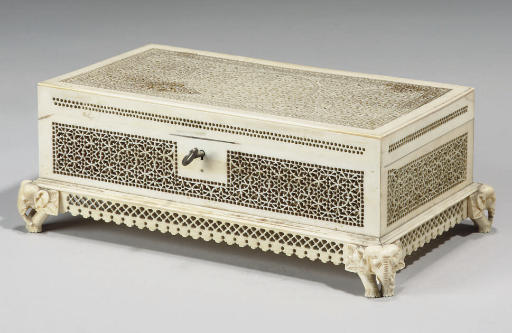 AN IVORY CARVED BOX AND CAMEL,
