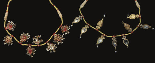 A PAIR OF GOLD AND GEM NECKLAC