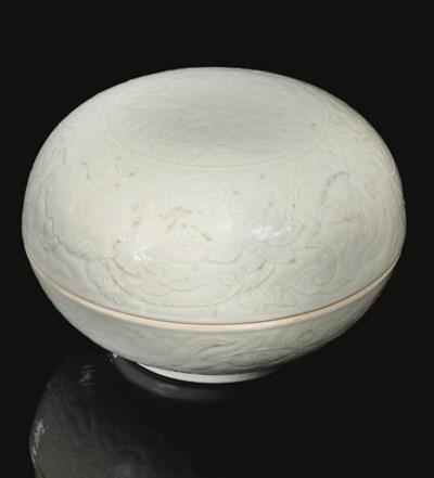 A white-glazed circular box an