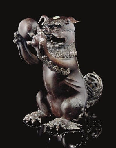 A bronze lion censer and cover