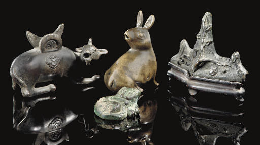 Four bronze small scholar orna