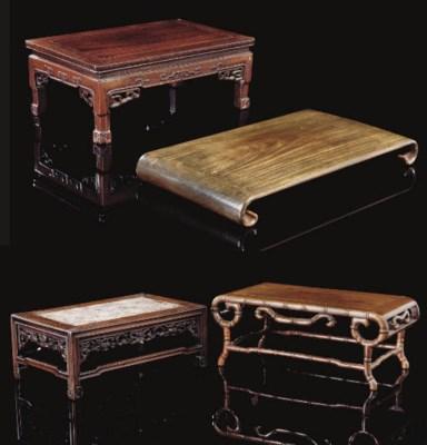 Four wooden rectangular stands