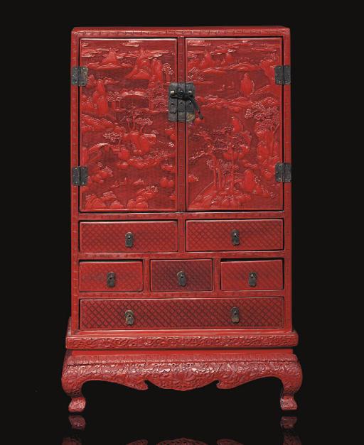 A Cinnabar lacquer cabinet, 19
