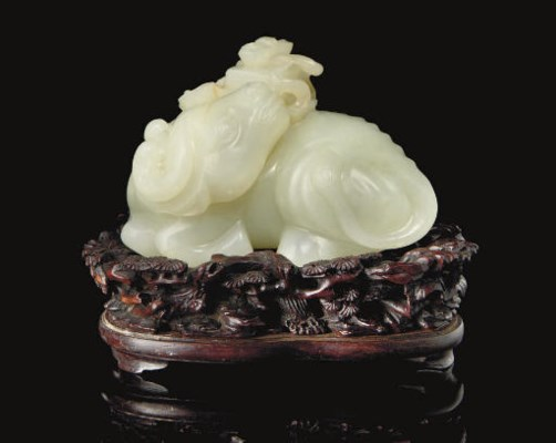 A white jade carving of a wate