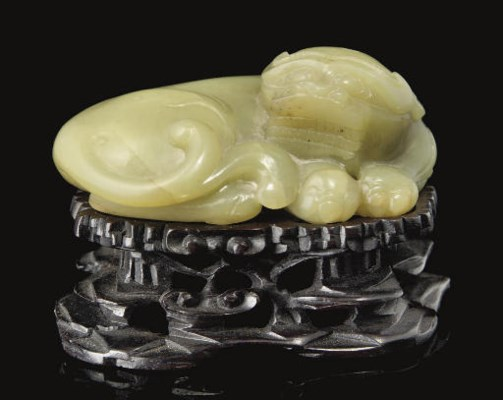 A yellow celadon jade model of