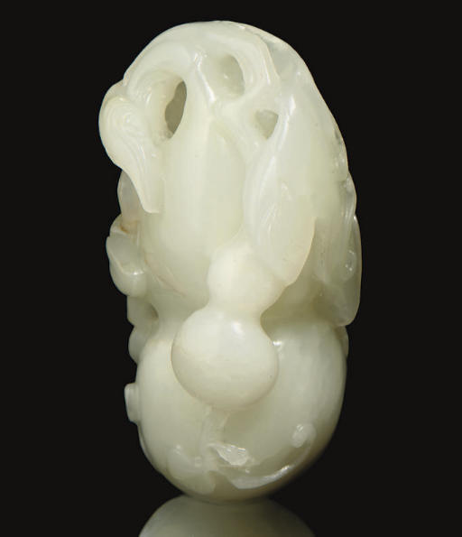 A white jade double-gourd carv