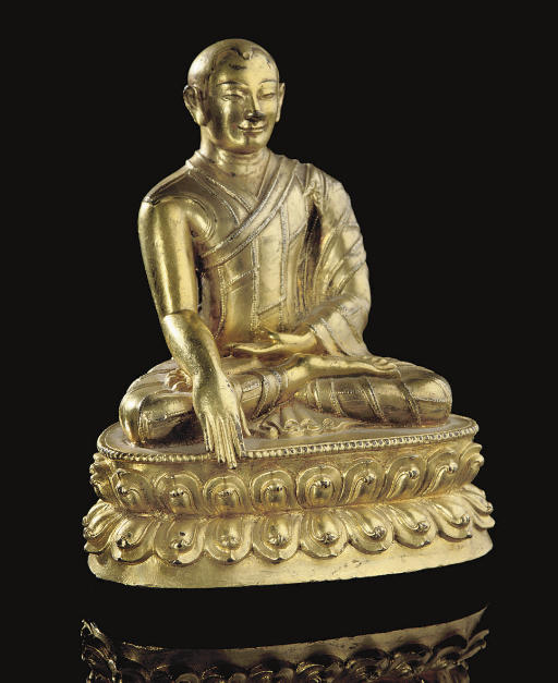A Sino-Tibetan gilt-bronze fig