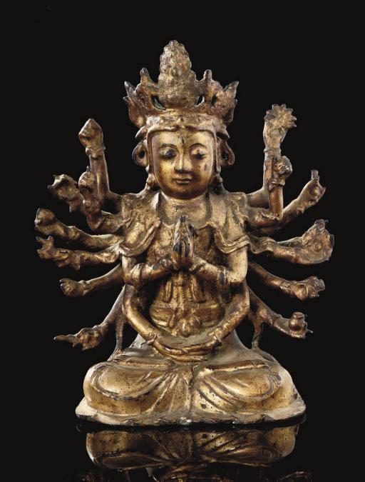 A gilt lacquered bronze figure