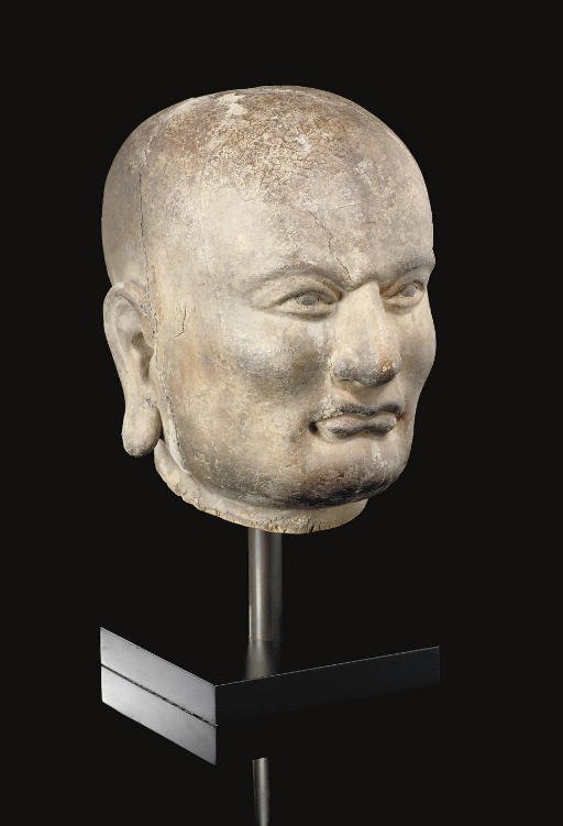 A lacquered wood head of a Luo