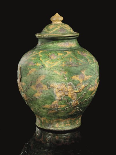 A Chinese moulded green glazed